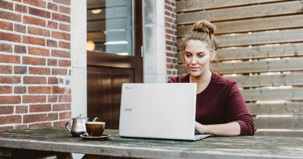 woman-working-on-laptop-outside-on-patio